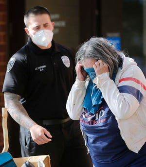 Saunis Parsons portrays a panhandler who is schizophrenic as Tallmadge police officer Jason Corzine attempts to help her during a Crisis Intervention Training exercise Friday at Northeast Ohio Medical University in Rootstown.