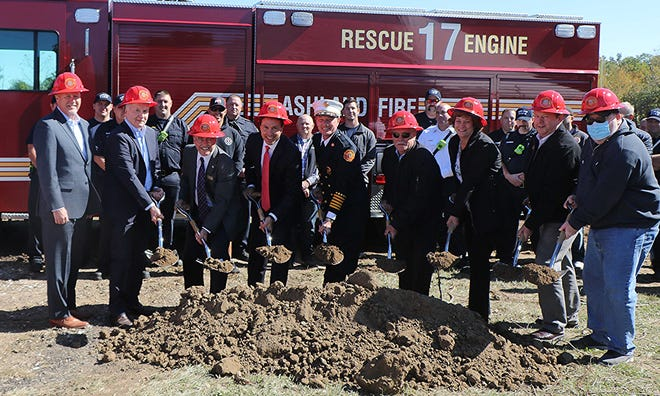 At Friday's groundbreaking for the Ashland Fire Department's second fire station are, from left, Todd Harford, president of UH Samaritan Medical Center; Dick Beal president of Samaritan Hospital Foundation; City Council member Steve Workman; Mayor Matt Miller; Ashland Fire Chief Rick Anderson; City Council member Dennis Miller; City Council member Angelia Woodard; City Council member Dan Lawson and City Council member Bob Valentine Jr. The 4.5-acre site at the corner of Mifflin Avenue and U.S. 42. was donated to the City of Ashland by University Hospitals Samaritan Medical Center.