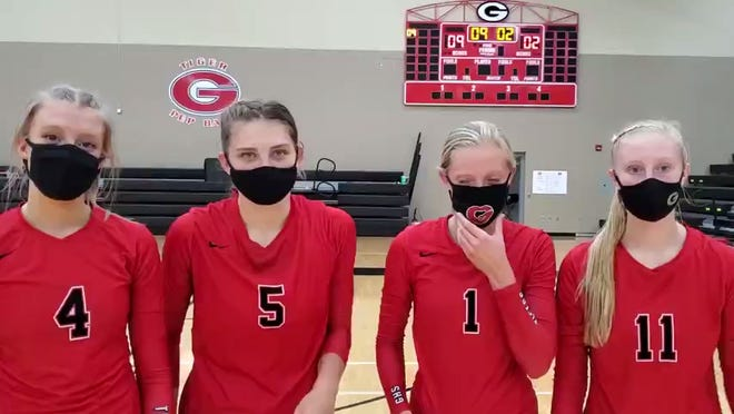 Gilbert's (L to R) Taylor Grinley, Thea Rotto, Erin Bathie and Nessa Johnson after the No. 10 Tigers' sweep of Perry Thursday at Gilbert
