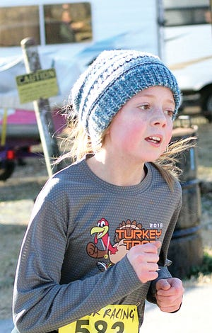 Emma Perry eyes the final stretch of last winter's Central Classic 5K in Bartlesville. During Friday's Owasso Classic cross country win, Perry turned in the third-fastest time for the Bartlesville middle school team.
