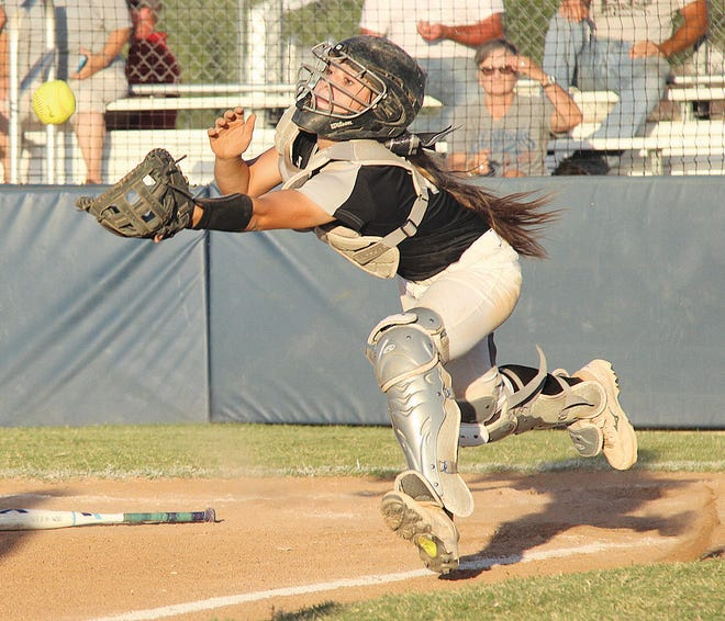 Oklahoma Union High catcher Rylee Lemos lunges to catch a pop fly during softball action in an earlier season in her career. Lemos are his Lady Cougar teammates went into Friday trying to earn a return to state.