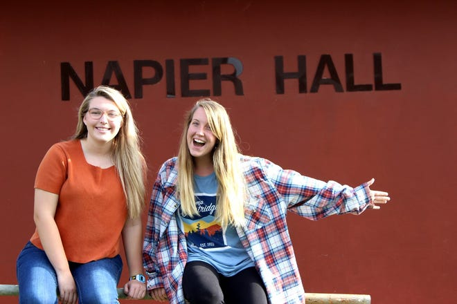 BCF students, Emily Straughn and Mary Klein, pose for a picture in front of Napier Hall