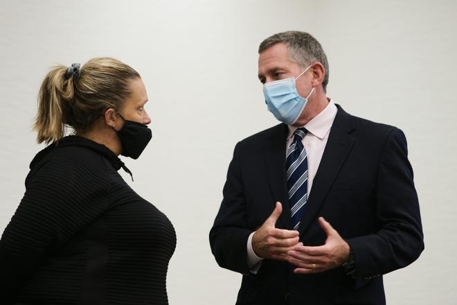 Judge Paul Herbert, right, talks with Tiffany Davis, left, about her success during his last day of CATCH Court on Thursday, Oct. 1, 2020 at the Greater Columbus Convention Center in Columbus, Ohio. After 11 years, Herbert is stepping down from the court, which focuses on survivors of human trafficking.