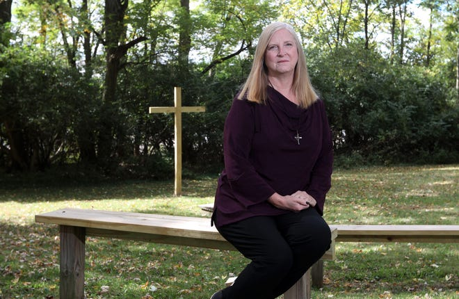The Rev. Deborah Bowsher poses at Trinity United Presbyterian Church's outdoor gathering place in Zanesville. Bowsher's church is hosting Red Cross blood drives during the pandemic, and overall she is encouraged by how young people are responding during the health crisis.