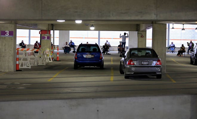 The Vox ensemble of the Columbus Gay Men's Chorus practices in a parking garage for its Friday concert in Huntington Park. [Kyle Robertson/Dispatch]