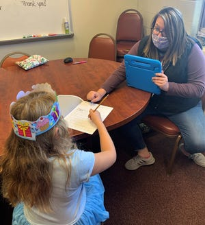 Morgan Snyder, a psychologist from the Muskingum Valley Educational Service Center, works with a student. Funds from the $2 million grant will help employ more mental health specialists like Snyder in rural school districts across seven Appalachian Ohio counties.