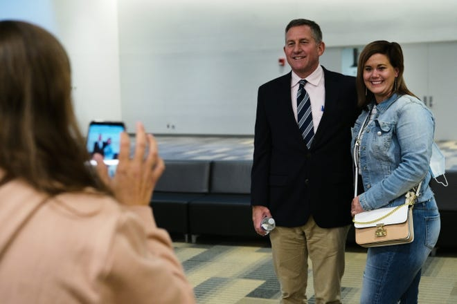 Judge Paul Herbert, center, poses for a picture with Natasha Cooper, right, on his last day of CATCH Court on Thursday, Oct. 1, 2020 at the Greater Columbus Convention Center in Columbus, Ohio. After 11 years, Herbert is stepping down from the court, which focuses on survivors of human trafficking.