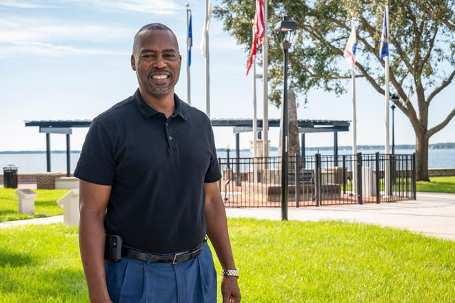 Air Force veteran Willie Hawkins, shown here standing in front of the flags at Ferran Park in Eustis, also had a long career as a member of the United States' Drug Enforcement Agency.