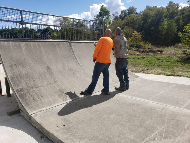 Ron Gombeda, executive director and Dick Dailey, project manager, CDC (Community Development Corp.) look at what needs done to get the half pipe at The Trailside Skate Park fixed.