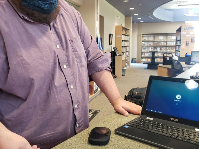 Luke Bentley, assistant director of the Guernsey County Public Library system, demonstrates the new Chromebooks with hotspots, put into circulation by the library on Oct.1.