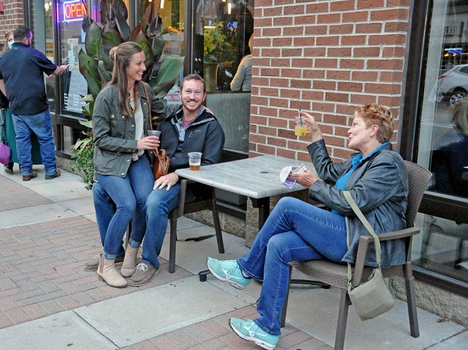 Katherine and Seth Abrecht take time to visit wiith mom, Paula Abrecht in front of Asian Bistro on West Liberty Street in downtown Wooster as they participate in the DORA program.