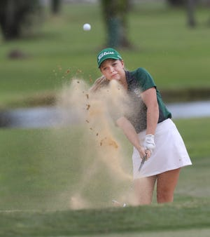 Flagler Palm Coast's Katie Parsons hits out of a bunker, Thursday October 1, 2020, at the Daytona Beach Golf Club.