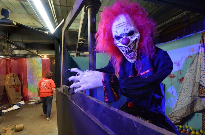 A clown prop greets visitors touring Eeriebyss Factory of Terror in Erie on Thursday. The half-mile haunted factory tour will be a bit different this year due to pandemic restrictions.
