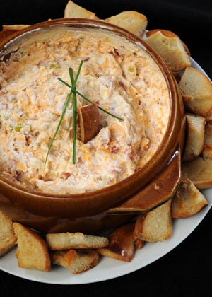 Warm Bacon Cheese Dip will keep everyone happy until the bird hits the table.