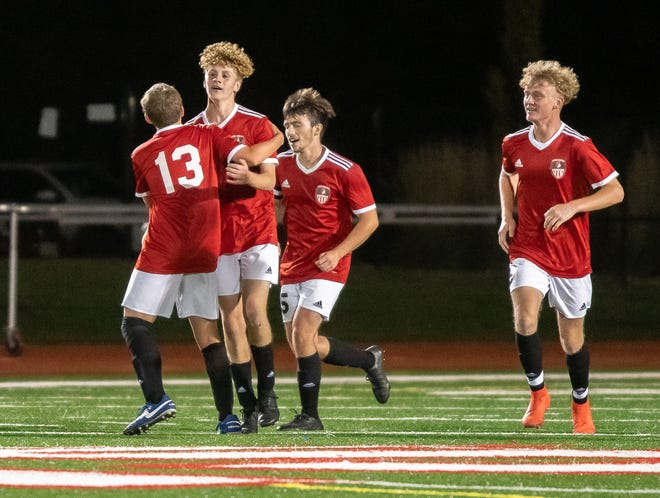 Fort Osage sophomore forward Lucca Smith is congratulated by teammate Xavier Steele (13) after scoring one of his two goals in Thursday's 3-2 win over rival William Chrisman.