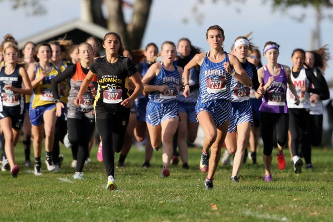 Runners take off at the start of the girls varsity race including Central Lee's Amanda Gilpin and Danville-New London's Addison Parrott at the Winfield-Mount Union Invite Thursday at the Twin Lakes golf course in Winfield.
