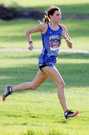 Danville-New London's Addison Parrott during the girls varsity race of the Winfield-Mount Union Invite Thursday at the Twin Lakes golf course in Winfield.