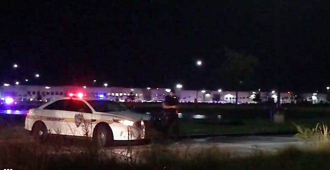 Police investigate Tuesday night's attempted murder-suicide at the Pecan Park Road Amazon fulfillment center.