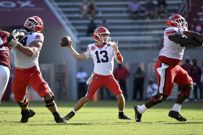 Georgia has to find out quickly if Stetson Bennett (13), seen here throwing against Arkansas last week, JT Daniels or somebody else is the answer for the Bulldogs at quarterback. With tough games coming up against Auburn, Tennessee and Alabama, they need stability at the most important position. (AP Photo/Michael Woods0
