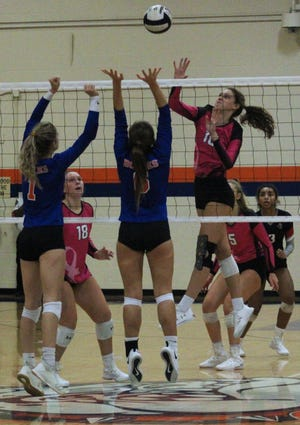 Creekside middle blocker Alli Jackson (10) leaps to spike a shot as Bolles' Grace Albaugh (1) and Regan Ponder (6) defend during a high school volleyball match Thursday.