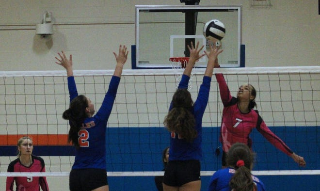 Creekside outside hitter Jaden McBride (7) leaps for a shot against the Bolles defense during a high school volleyball match in October.