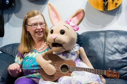 Jacksonville resident Debbie Dewart and her ventriloquist doll Cherry the Resurrection Rabbit singing a song about spreading the word of God.