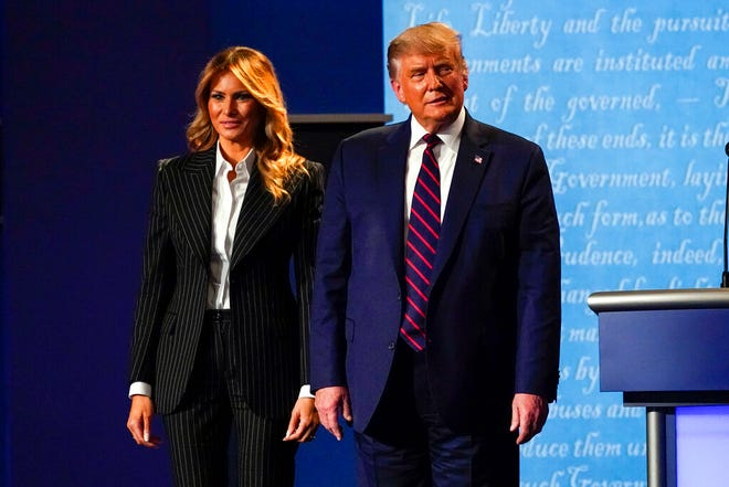 President Donald Trump stands on stage with first lady Melania Trump after the first presidential debate with Democratic presidential candidate former Vice President Joe Biden on Sept. 29 at Case Western University and Cleveland Clinic. The president Trump and first lady have tested positive for the coronavirus, the president tweeted early Friday.