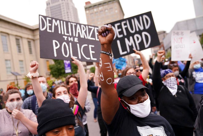 FILE - In this Sept. 23, 2020, file photo, protesters speak in Louisville, Ky. Hours of material in the grand jury proceedings for Taylor's fatal shooting by police were made public on Friday, Oct. 2.