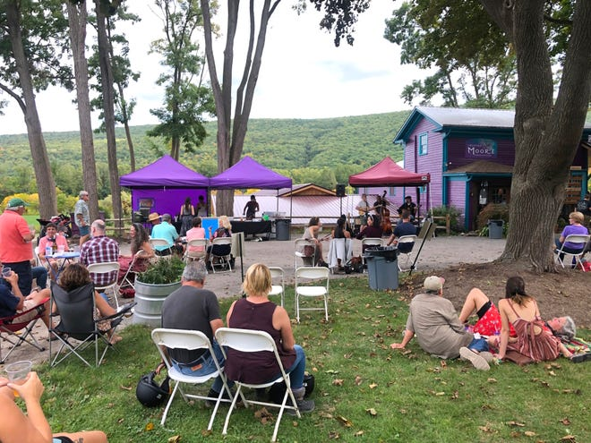 The lawn outside Inspire Moore Winery is seen last weekend as folks socially distanced in  their own groups to listen to live music.
