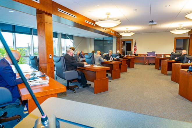 Members of the Ontario County Board of Supervisors prepare for their first meeting at the newly renovated county building at 74 Ontario St.
