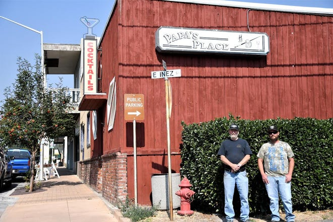 Dave Culbertson and Daniel Anderson stand in front of Papa's Place on Weed's Main Street, which has closed its doors for good.