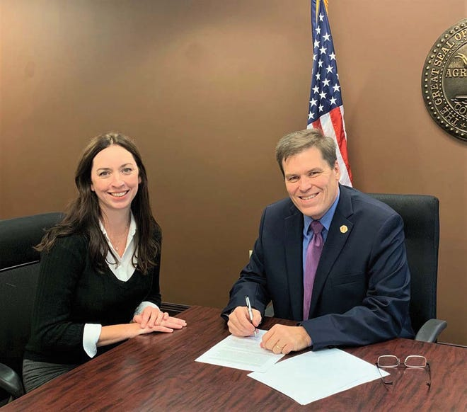 Melissa Miller and District Attorney General Dave Clark meet to sign the grant contract to establish the Anderson County Family Justice Center.