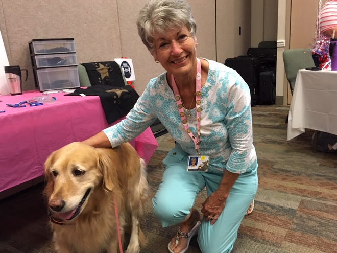 Hospice of Marion County 2019 Volunteer of the Year Sharon Rinschler poses with Dakota recently. This organization is one of many in Ocala/Marion County that relies on volunteers.