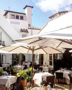 Continental cuisine is served in the outdoor courtyard at Renato's in historic Via Mizner.