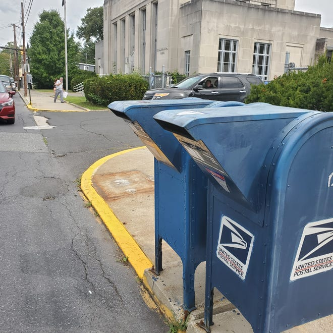 The outline of a missing mailbox, left, outside the Stroudsburg Post Office on Ann Street next to two other collection boxes.