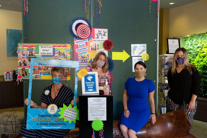 Members of the Delray Beach Chamber of Commerce pose with masks. The chamber helped the Historical Society's project by submitting an essay about their efforts to help the city during the COVID-19 crisis.