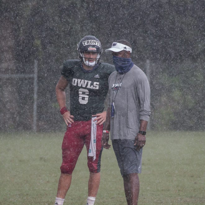 During a practice this week, FAU coach Willie Taggart talks with starting quarterback Nick Tronti