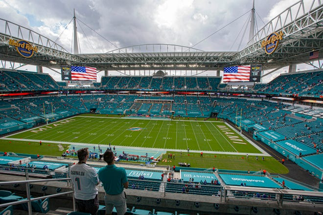Hard Rock Stadium was socially distanced when the Dolphins played their home opener last month against the Bills and both teams stayed in their locker rooms during the national anthem.