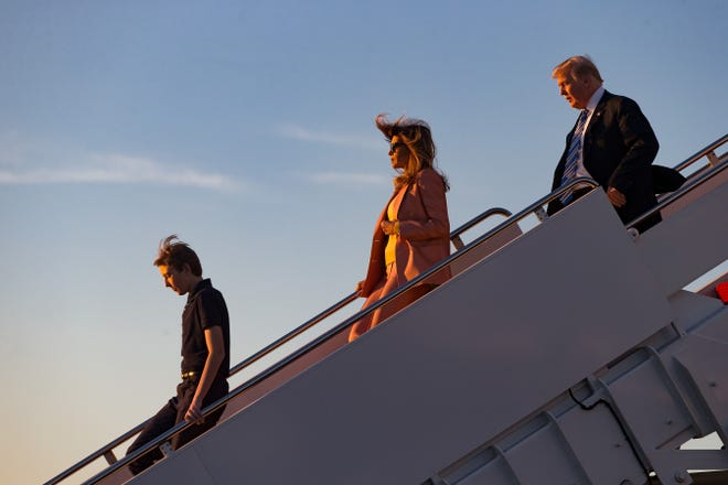 Barron, Melania and President Donald Trump arrive on Air Force One at Palm Beach International Airport on March 23, 2018.