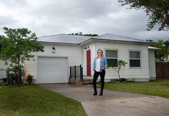 Christen Hutton, who bought her house this year was awarded a grant from town of Jupiter to renovate the historic home built in the 1940s. [MEGHAN MCCARTHY/palmbeachpost.com]