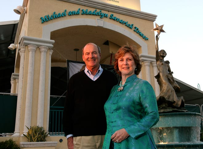 Charlie Siemon, left, and Wendy Larsen, founders of the Centre for the Arts at Mizner Park and the annual festival pose for a photo in front of  the amphitheater in Boca Raton in 2010.