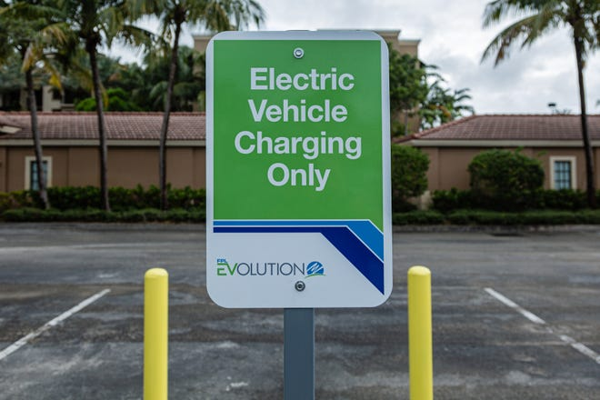 A sign marking the electric car charging station at Midtown in Palm Beach Gardens, Friday, October 2, 2020. Florida Power & Light is commemorating National Drive Electric Week with the debut of a new electric vehicle universal fast-charging station at Mainstream in Midtown in Palm Beach Gardens. Customers will be charged about 30 cents per kilowatt hour to charge their electric vehicles. [JOSEPH FORZANO/palmbeachpost.com]
