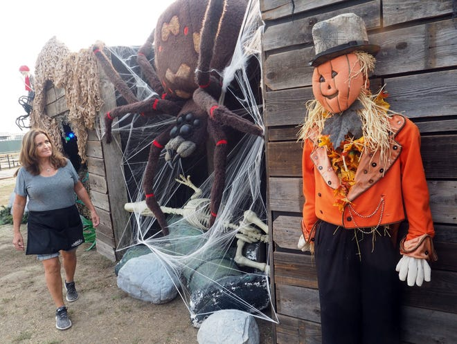 Mary Mantor checks the new Haunted Village attraction at Dell'Osso Farm, which will offer its popular corn maze and giant pumpkin patch again this year.