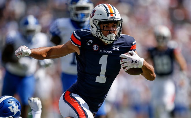 Auburn wide receiver Anthony Schwartz runs for a first down after catching a pass in last week's win over Kentucky. Auburn hosts Georgia on Saturday in a key early season showdown in the SEC.