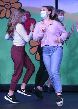 """Jackson senior Emma Maier practices during the school's production of the """"Wizard of Oz"""" on Thursday. Maier overcame a cancerous brain tumor to land the lead role."""