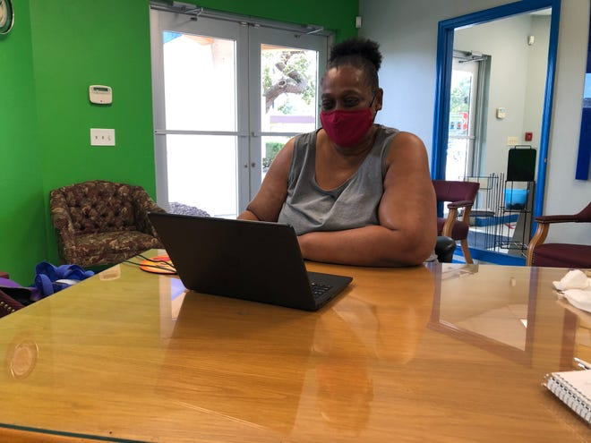 Liz Allen looks for work at Goodwill Manasota's Job Connection office in Newtown on the computer she received from the Tech to Connect pilot program.