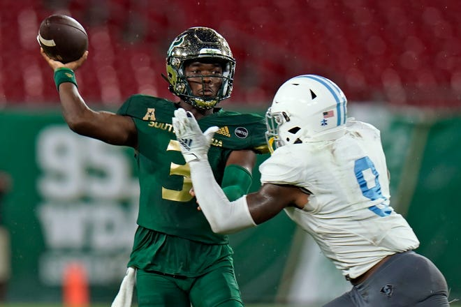 South Florida quarterback Jordan McCloud (3) is pressured by Citadel linebacker Willie Eubanks III (9) as he throws a pass during the first half of an NCAA college football game Saturday, Sept. 12, 2020, in Tampa, Fla. (AP Photo/Chris O'Meara)