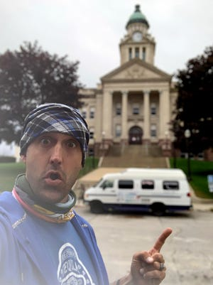 """Drew Devine, 36, a Sarasota artist and Minnesota native, has embarked on a 50-state """"art and kindness"""" road trip."""