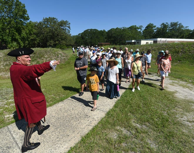 Jim McKee, site manager at Brunswick Town/Fort Anderson State Historic Site, leads a tour for the Cape Fear Unearthed podcast in Winnabow, N.C., Saturday, July 20, 2019. [MATT BORN/STARNEWS]