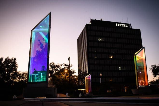 The Prismatica exhibit consists of 25, 6-foot-tall rotating interactive light prisms. The prisms have been set up at four locations in downtown Fayetteville. [Andrew Craft/ The Fayetteville Observer]